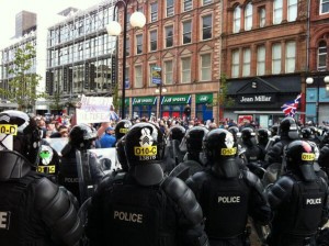 Police hold back loyalists in Royal Avenue