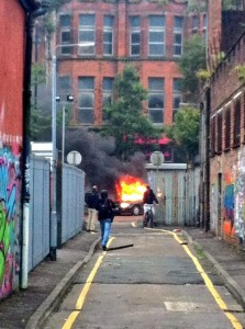 A car is set on fire in north Belfast as loyalists and republicans rioted in Belfast on Friday evening