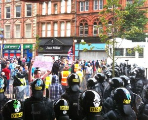 A tense stand off has developed between loyalists and PSNI riot squad officers