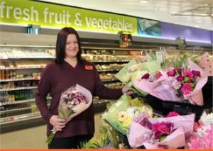 A member of staff working at Sainbury
