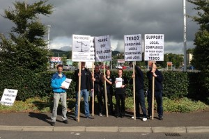 Shopfitting workers are picking Tesco HQ in Northern Ireland today over job losses