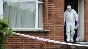 Forensic officers at the scene of a fatal stabbing in Dungannon on Thursday
