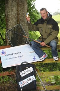 HOOK, LINE AND...WINNER.  Mark O''Donoghue from Enniskillen fishes himself a £100k win on a National Lottery scratchcard