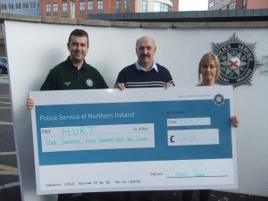 Crime Team cheque presentation Constable Daryl Watton (left), PSNI Crime Team, presenting a cheque for £1,410 to Dessie Kyle, HURT centre manager, and Pauline McCloskey, HURT finance manager.