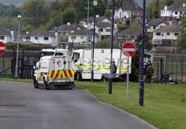 Army technical officers make safe a pipe bomb thrown at police in Strabane last month.