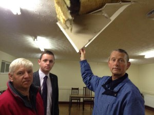 Alderman Maurice Devenney, Councillor Gary Middleton and Grand Master James Hetherington inspect damage to Fawney Orange Hall