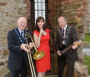 Dungannon and South Tyrone Borough Council Deputy Mayor Robert Mulligan, Swing Gal founder Karen Kirby and Dungannon and South Tyrone Borough Council Mayor Sean McGuigan take centre stage to launch this year's FestiveHill13 line-up at Hill of The O'Neill and Ranfurly House Arts and Visitor Centre in Dungannon. The week-long festival kicks-off on Saturday 21st September w