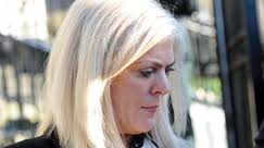 Bleached blonde crook Kathy Ward arrives at court in Downpatrick rather camera shy