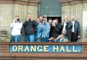 EYE SPY...Winky Irvine (thrid left) watching from the top of Ligoniel Orange Hall
