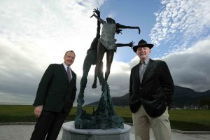 Howard Hastings (left) is pictured with renowned sculptor Paddy Campbell, beside his creation 'Wind and Sea' at the Slieve Donard Resort and Spa.