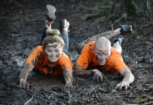 MUDDY MAYHEM... Online fitness enthusiast Peanut Butter Girl aka Tiffany Brien gets 'jaffa-caked' in mud alongside the reigning McVitie's Jaffa Cakes Mud Madness champion Keith Clarke ahead of this year's race.