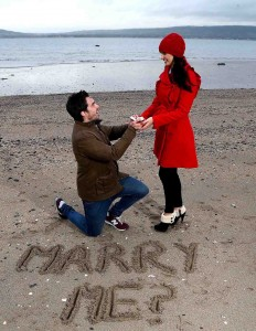 MAGIC QUESTION... 'Model couple' Michael McCann and Anna Henry enjoy an engagement on the beach as the Northern Ireland Tourist Board (NITB) is spreading the message of love by highlighting some of the most romantic hotspots and stunning locations to woo that special person in your life.