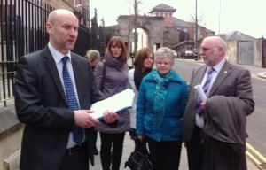 DCI Mark McClarence with the family of Phillipa Reynolds outside court