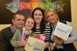 Power NI's Susan Hutchinson pictured with Jonathan and Katie (age 5) from Belfast  join Power NI's Aine Bloomer to help power the launch of the Elements exhibition at the Ulster Museum.