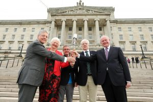The Queen's baton for the Commonwealth Games was presented to Northern Ireland's First Minister, Peter Robinson MLA and deputy First Minister, Martin McGuinness MLA by Dame Mary Peters. Also pictured is Chris Jenkins, Chief Executive, Commonwealth Games and Robert McVeigh, Chairman of Commonwealth Games NI. PIC: PRESSEYE
