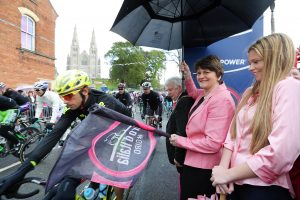 Pictured starting the third stage of the race, the Minister cheered the cyclists as they began their journey to Dublin.   Picture by Kelvin Boyes / Press Eye.