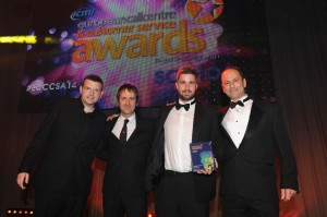 Comedian Kevin Bridges, Ash Schofield from giffgaff, Richard Elwell from Firstsource Solutions and Presenter award Firstsource 'Outsourcing Partnership of the Year' with giffgaff at the European Call Centre and Customer Service awards.