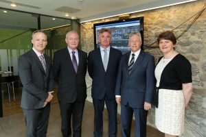 Peter Robinson and Martin Mc\Guinness  pictured with Brian Conlon, CEO, First Derivatives plc, centre, and Kevin Cunningham (MRP), far left, and Enterprise Minister Arlene Foster.