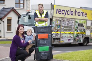 Danielle Shields Oliver Shields with Gareth Townsley from Bryson Recycling put the new 'Wheelie Box' to test.