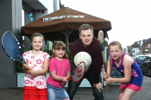 PIZZA THE ACTION… Luke Wolsey, Managing Director of Little Wing Pizzeria, joins Meghan Cahill (7), Chole Cahill (6) and Caoimhe McDonnell (9) as Little Wing launches its Little Sports Star bursary programme