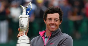 Rory McIlroy proudly holds the Open Championship Claret Jug