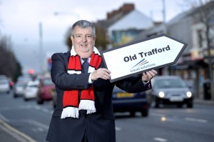 NEW DAWN: Peter McMinn, managing director of Travel Solutions, Northern Ireland's leading independent specialist tour operator, launches the company's new range of Manchester United packages