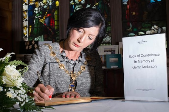 The Mayor Councillor Brenda Stevenson signs a Book of Condolence in memory of  broadcaster Gerry Anderson in the Guildhall in his home city. Picture Martin McKeown.