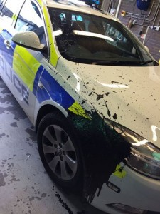 The damaged caused to the police vehicle after it was attacked by masked men