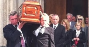 Pals Mickey Bradley and Sean Coyle carry the coffin of Gerry Anderson out of St Eugene's Cathedral today