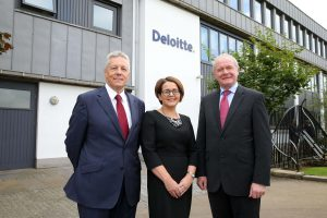 First Minister Peter Robinson and deputy First Minister Martin McGuinness are pictured with Consulting Partner, Deloitte Jackie Henry.. PIC: KELVIN BOYES/PRESSEYE