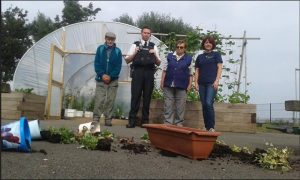 Charity volunteer, Billy Nicholson with Constable Gillies, York Road NPT, Joan Nicholson, Volunteer and Helen Tomb, Project Manager, The Conservation Volunteers.