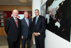 First Minister Peter Robinson and deputy First Minister Martin McGuinness are pictured with Paul Terrington, PwC Regional Chairman.