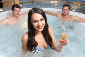 Model Rebekah Shirley is joined by Belfast Giants players Craig Peacock and Adam Keefe to celebrate the announcement that Belfast beauty specialists, Taylormade Treatments has taken over the operation of the Nordic Spa onboard the Stena Line Belfast to Cairnryan route.