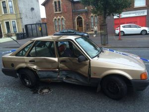 The stolen Ford Escort car which crashed in Woodvale, west Belfast