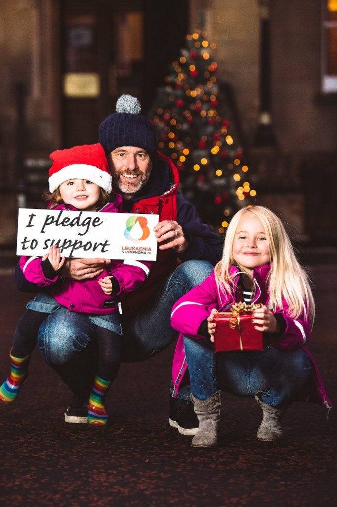 MAKE A PLEDGE… Leukaemia survivor Tony Miskelly from Bangor joins his daughters Freyja (6) and Emme (2) to ask people to support Northern Ireland's only blood cancer research charity Leukaemia & Lymphoma NI as it marks the end of its 50th anniversary year.