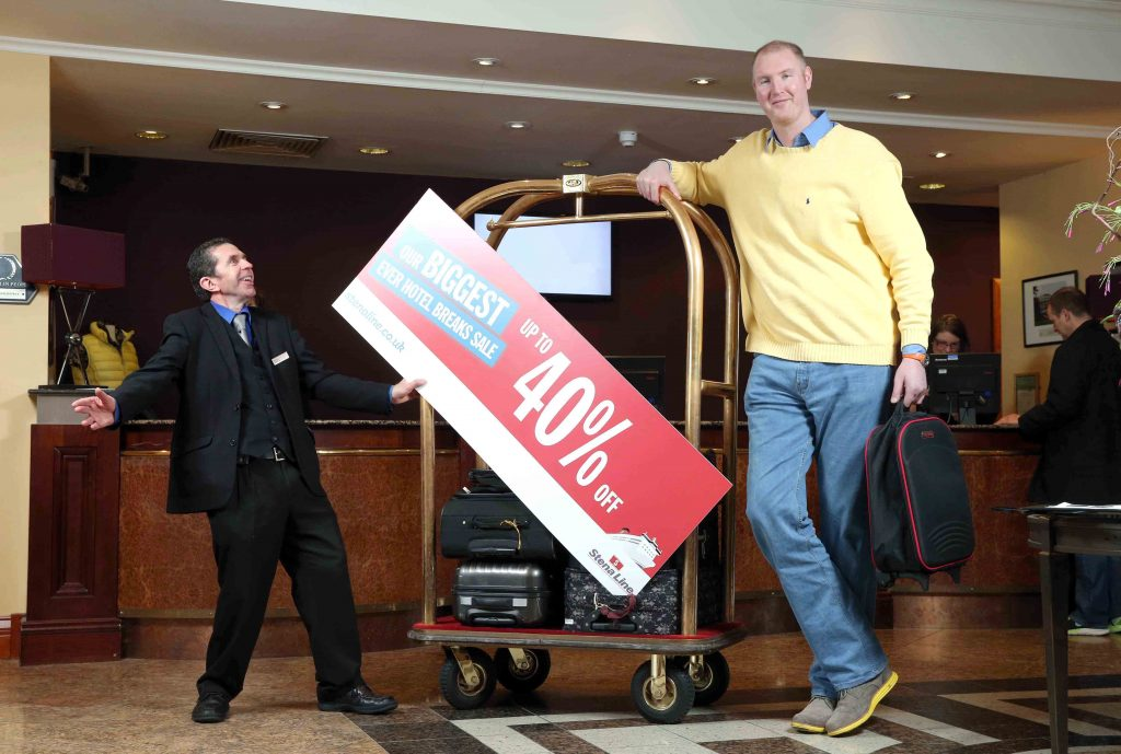 """EUROPE'S tallest man, Neil Fingleton, who stands at a staggering 7' 7"""" ¾ sailed into Northern Ireland today to reveal details of ferry company Stena Line's biggest ever hotel breaks sale"""