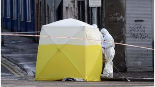 A forensic tent covers the murder scene at Botanic Avenue in south Belfast