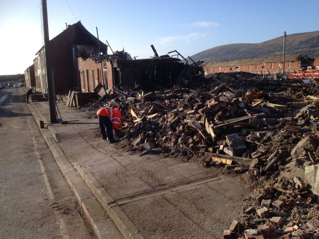 The aftermath in Lawnbrook Avenue after walls collapsed in the derelict Shankill homes