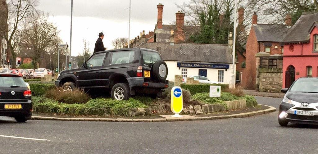 'Johnny The Wally' lands his jeep on a Belfast roundabout looking for a parking space