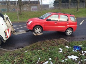 A Suzuki car is towed away after it was to have no valid car insurance
