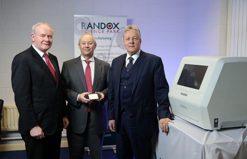 First Minister Peter Robinson and the deputy First Minister Martin McGuinness are pictured with Managing Director of Randox, Dr Peter FitzGerald, after announcing that the global diagnostics is to create 540 quality jobs over four years. PICTURE: KELVIN BOYES/PRESSEYE