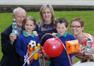 Launching this year's awards are Action Cancer Chairman, Norman Carson, Action Cancer's PR & Events Officer Lucy McCusker and Centra Brand Manager Nikki McDowell along with Erin McGrath and Lewis Vance from Trinity Nursery School, Bangor.