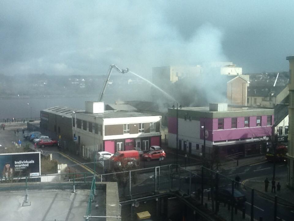 Fire crews on an aerial platform tackling the blaze at the Mandarin Palace Chinese restaurant