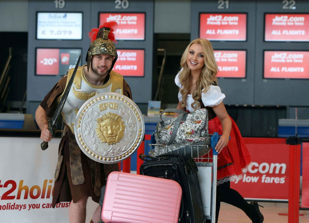 AND WE'RE OFF.... to Rome and Prague! 'Czech' beauty Meagan Green and 'Roman Centurion' Reuben Hassan celebrate a milestone week for Jet2.com and Jet2holidays which will see the company's inaugural flights to Rome on Thursday April 2 and Prague on Friday April 3 jet off from Belfast International Airport.