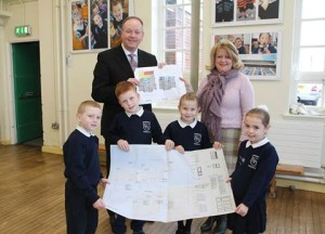 William Humphrey views the extension plans along with Springfield Primary School Principal Kathryn Haugh and P3 pupils Mason Martin, Harley Sterling, Madison White and Ashleah Cowan.