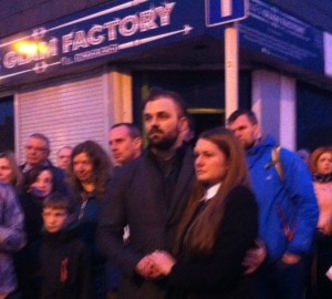 Lithuanian woman Asti surrounded by supporters outside her gutted shop on Tuesday night