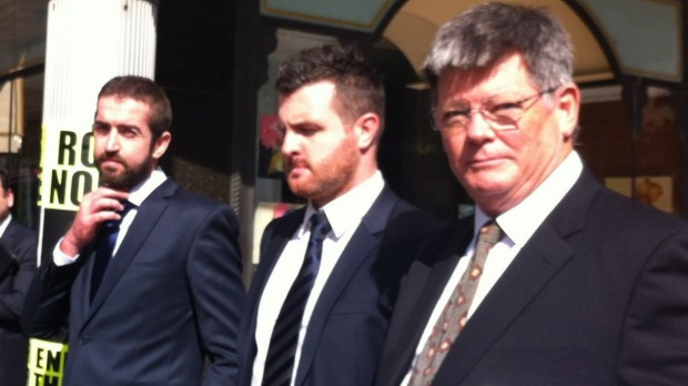 Patrick and Barry Lyttle leave court in Sydney with defence lawyer Christ Watson