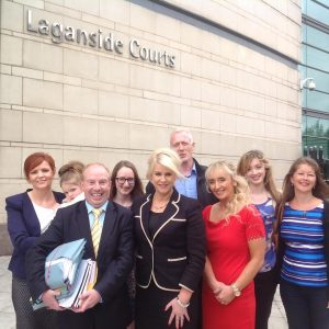 Bernie Smyth (front black dress) with her supporters and solicitor Aiden Carlin outside court this afternoon