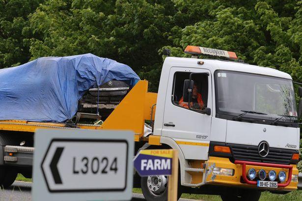 Kathryn Jones's Opel car is taken away from the crash scene