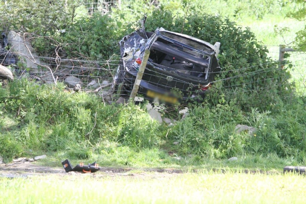 The mangled wreckage of the car which claimed the lives this morning of two cousins